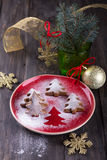 Homemade Christmas cookies in the shape of a Christmas tree, sprinkled with powdered sugar Stock Photography