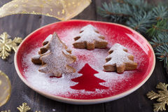 Homemade Christmas cookies in the shape of a Christmas tree, sprinkled with powdered sugar Stock Photos