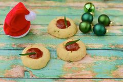 Homemade Christmas cookies. Homemade Christmas thumbprint rosemary cookies on green background Royalty Free Stock Photography