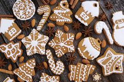 Homemade Christmas cookies on a wooden background. With anise and almond Royalty Free Stock Photo