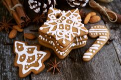 Homemade Christmas cookies on a wooden background. With with star anise almond and cinnamon sticks Royalty Free Stock Photos