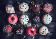Christmas decoration on donuts Royalty Free Stock Photos