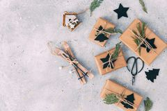 Homemade Christmas gift in kraft paper. Free space for text. Flat lay background Stock Image