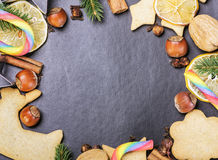 Homemade Christmas gingerbread cookies on a black background Stock Photos