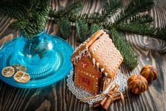 Homemade Christmas Gingerbread House displayed on a table. Christmas tree lights in the background. stock images