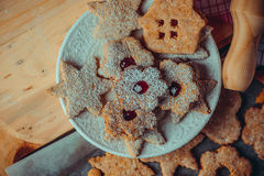 Homemade Christmas gingerbread and linzer cookies with jam, powdered, top flat view, instagram filetr, vintage Royalty Free Stock Images