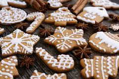 Homemade christmas gingerbread on a wooden background with star anise and almond. Homemade christmas gingerbread on a wooden background Royalty Free Stock Image