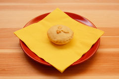 Homemade Christmas mince pie with a yellow napkin Royalty Free Stock Image