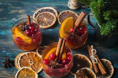 Homemade Christmas mulled red wine with spices, cinnamon and citrus fruit on rustic wooden background, traditional winter hot drin. Christmas mulled red wine stock photo