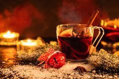 Christmas mulled wine. Homemade christmas mulled wine or hot tea with cinnamon, anise and oranges. Toned image. Selective focus Royalty Free Stock Photos