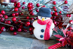 Homemade christmas snowman beside branch with berries Stock Image