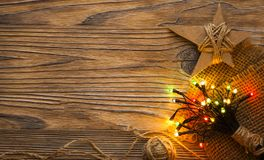 Homemade Christmas star with lights illuminated on a wooden back. Ground, cardboard decoration stock images
