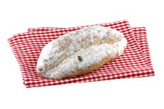 Homemade Christmas stollen cake on a cloth Royalty Free Stock Photo