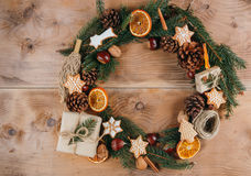 Homemade Christmas wreath. Christmas wreath with cookies, gifts,  and natural ornaments Stock Photography