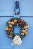 Homemade Christmas Wreath Hanging On Blue Door Royalty Free Stock Image