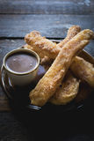 Homemade churros and hot chocolate Royalty Free Stock Photos