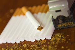 Homemade cigarettes with fresh tobacco Royalty Free Stock Photography