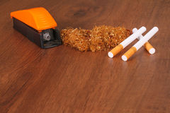 The Homemade cigarettes made with tobacco and other equipment Stock Image