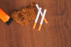 The Homemade cigarettes made with tobacco and other equipment Stock Photography