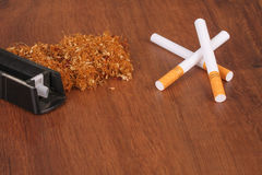 The Homemade cigarettes made with tobacco and other equipment Royalty Free Stock Image