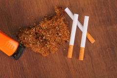 The Homemade cigarettes made with tobacco and other equipment Stock Images