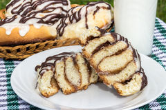Homemade cinnabon cinnamon buns with cream cheese glaze and chocolate icing Stock Photography