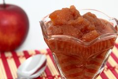 Homemade Cinnamon Applesauce Close-Up. A serving of hot freshly made home-style cinnamon applesauce served in a clear glass dessert dish Stock Image