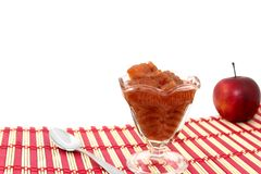Homemade Cinnamon Applesauce. Served in a clear glass dessert dish and placed on a red and tan natural placemat Stock Images