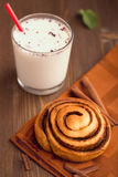 Homemade cinnamon bun with hot milk Stock Photography