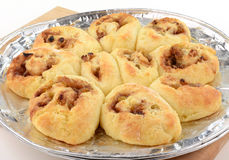 Homemade cinnamon buns. Home made cinnamon buns on pizza pie plate fresh from the oven Stock Image