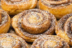 Homemade cinnamon buns as background. Stock Photos