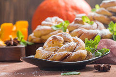 Homemade cinnamon buns with pumpkin Royalty Free Stock Photos