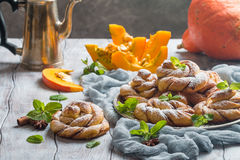 Homemade cinnamon buns with pumpkin Stock Photos