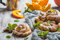 Homemade cinnamon buns with pumpkin Royalty Free Stock Photo