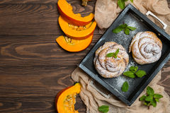 Homemade cinnamon buns with pumpkin Stock Photo