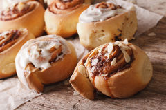Homemade cinnamon rolls with almond close up on the table. Royalty Free Stock Photos