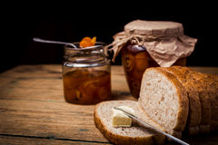 Homemade citrus orange jam on toast over wooden table Royalty Free Stock Photo