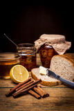 Homemade citrus orange jam on toast over wooden table Stock Photography