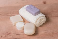 Homemade clean natural soap and towel. Homemade clean natural soap with towel on wooden table taken in studio, zero waste product, ecological royalty free stock photography