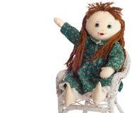 Homemade Cloth Doll Points Toward Copy Space Royalty Free Stock Photos
