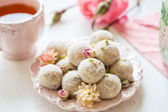 Homemade coconut balls decorated with little pink flowers Stock Photos