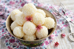 Homemade coconut bites in metal bowl Stock Photo