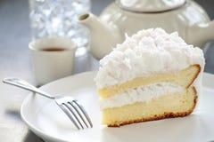 Homemade coconut cake. On white plate Stock Image