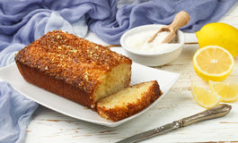 Homemade coconut citrus cake with lemon syrup Royalty Free Stock Photo