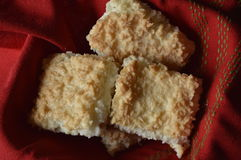 Homemade coconut cookies. Homemade cookies with coconut, coconut cookies, coconut cake, on red cloth stock photography