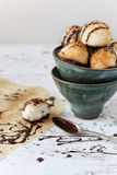 Homemade coconut macaroons with dripped dark chocolate on bowl Royalty Free Stock Image