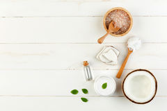 Homemade coconut products on white wooden table background. Oil, Royalty Free Stock Images