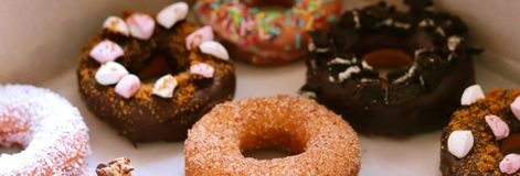 Homemade colorful donuts made with love royalty free stock photo