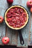 Homemade comfort food. Raw apple rose pie in cast iron pan with stock photography