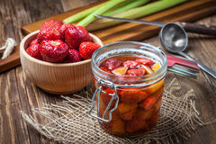 Homemade compote of rhubarb and strawberries. Royalty Free Stock Photos